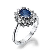 """טבעת """"הנסיכה דיאנה"""" 14 קראט משובצת 12 יהלומים במשקל כולל של 0.36 נקודות ואבן ספיר"""
