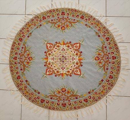 שטיח צמר עגול עבודת יד בצבעי תכלת פרחוני במגוון גדלים לבחירה