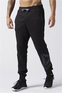מכנסי אימון לגבר REEBOK גזרת סלים בצבע שחור