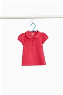 חולצת פולו לבנות מבד כותנה סטרץ' ושרוולים נפוחים בצבע ורוד