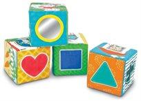 4 קוביות משחק והתפתחות רכות